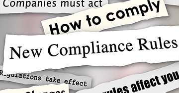 Headlines ripped from a newspaper that read new compliance rules